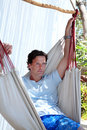 Handsome middle aged man sitting in hammock Stock Images