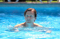 Handsome middle aged man swimming in outdoor pool Stock Photos