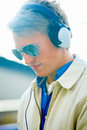Handsome modern dj using headphones Stock Photos