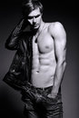 Handsome muscled fit male model man in leather jacket Royalty Free Stock Photo