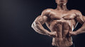 Handsome muscular bodybuilder posing on Front Lat Spread Royalty Free Stock Photo