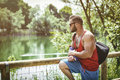 Handsome muscular hunk man outdoor in city park during daytime wearing tanktop and sunglasses Stock Images
