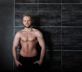 Handsome muscular male model near the wall with copy space Stock Photo