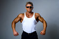 Handsome muscular man dark glasses white shirt Royalty Free Stock Images