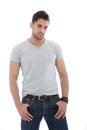Handsome muscular man posing with hands on his pocket Stock Images