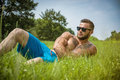 Handsome Muscular Shirtless Hunk Man Outdoor in City Park Royalty Free Stock Photo