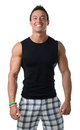 Handsome muscular young man smiling isolated on white with black tanktop Royalty Free Stock Photos