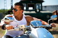 Handsome muscular young man sunglasses motorcycle Stock Photos