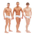 Stock Image Handsome naked guys posing in white briefs