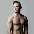 Handsome naked male fashion photo of with strong body Royalty Free Stock Photography