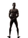 Handsome naked muscular man standing full length silhouette one caucasian tanding in studio on white background Stock Photography