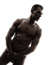 Handsome naked muscular man standing portrait silhouette one caucasian men in studio on white background Royalty Free Stock Images