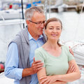 Handsome old man whispering into wife's ears Stock Photos