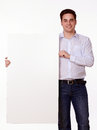 Handsome person holding up blank placard portrait of a a while standing and smiling on isolated studio copyspace Royalty Free Stock Photography