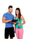 Handsome personal trainer with a attractive girl isolated on white background Royalty Free Stock Images