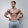 Handsome power athletic young man with great physique Royalty Free Stock Photo