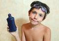 Handsome preteen boy with anti sunburn cream Stock Photo