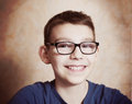 Handsome preteen boy  with correction myopia glasses Royalty Free Stock Photo