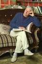 Handsome retired man reading book portrait of Stock Photos