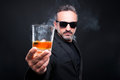 Handsome rich guy inviting you to drink scotch Royalty Free Stock Photo