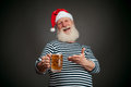 Handsome sailor seaman santa claus with beer isolated on black background Stock Image