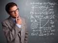 Handsome school boy thinking about complex mathematical signs young Stock Photo