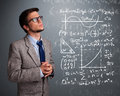 Handsome school boy thinking about complex mathematical signs young Royalty Free Stock Photos