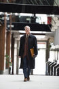 Handsome senior business man walking Royalty Free Stock Photo