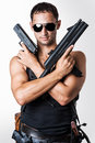 Handsome sexy military man wearing black fashion sunglasses with automatic and hand gun Stock Image