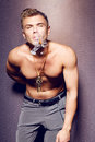 Handsome sexy young man with naked torso smoking a cigar Royalty Free Stock Photo