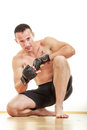 Handsome shirtless young man fighter with sport gloves portrait of muscular Stock Photography