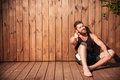 Handsome smiling bearded man sitting and pointing finger at you Royalty Free Stock Photo