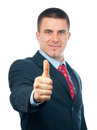 Handsome smiling businessman showing thumbs up