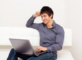 Handsome smiling man surfing the net. Stock Image