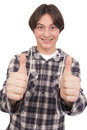Handsome smiling teenager showing thumbs up white background Royalty Free Stock Photo