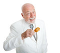 Handsome southern gentleman eating delicious southern fried chicken isolated on white Stock Images
