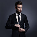 Handsome stylish man in black suit