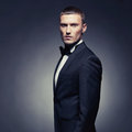 Handsome stylish man portrait of in elegant black suit Royalty Free Stock Image