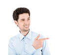 Handsome success man with pointing gesture close up portrait of a successful businessman smiling and on the copy space isolated on Stock Photography