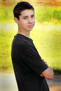Handsome teen boy a side view of a young with dark hair and black shirt shallow depth of field Royalty Free Stock Photos