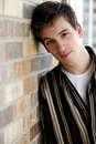 Handsome teen leaning on wall Royalty Free Stock Image