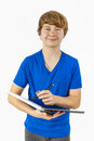 Handsome teenage boy with blue portrait of shirt Royalty Free Stock Photo