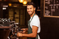 Handsome waiter serving coffee cup Royalty Free Stock Photo
