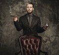 Handsome well dressed man with glass of beverage and cigar Stock Images