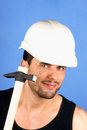 Handsome worker with hard hat and hammer Stock Photo