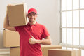 Handsome worker helping to move Royalty Free Stock Photo