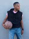 Handsome young african american man holding basketball portrait of a Stock Photos