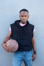 Handsome young african american man holding basketball portrait of a Royalty Free Stock Photos