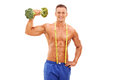 Handsome young athlete holding a broccoli dumbbell posing shirtless with in his hand and measuring tape around his neck isolated Stock Photos