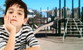 Handsome Young Boy Child Bored at Park. Royalty Free Stock Photo